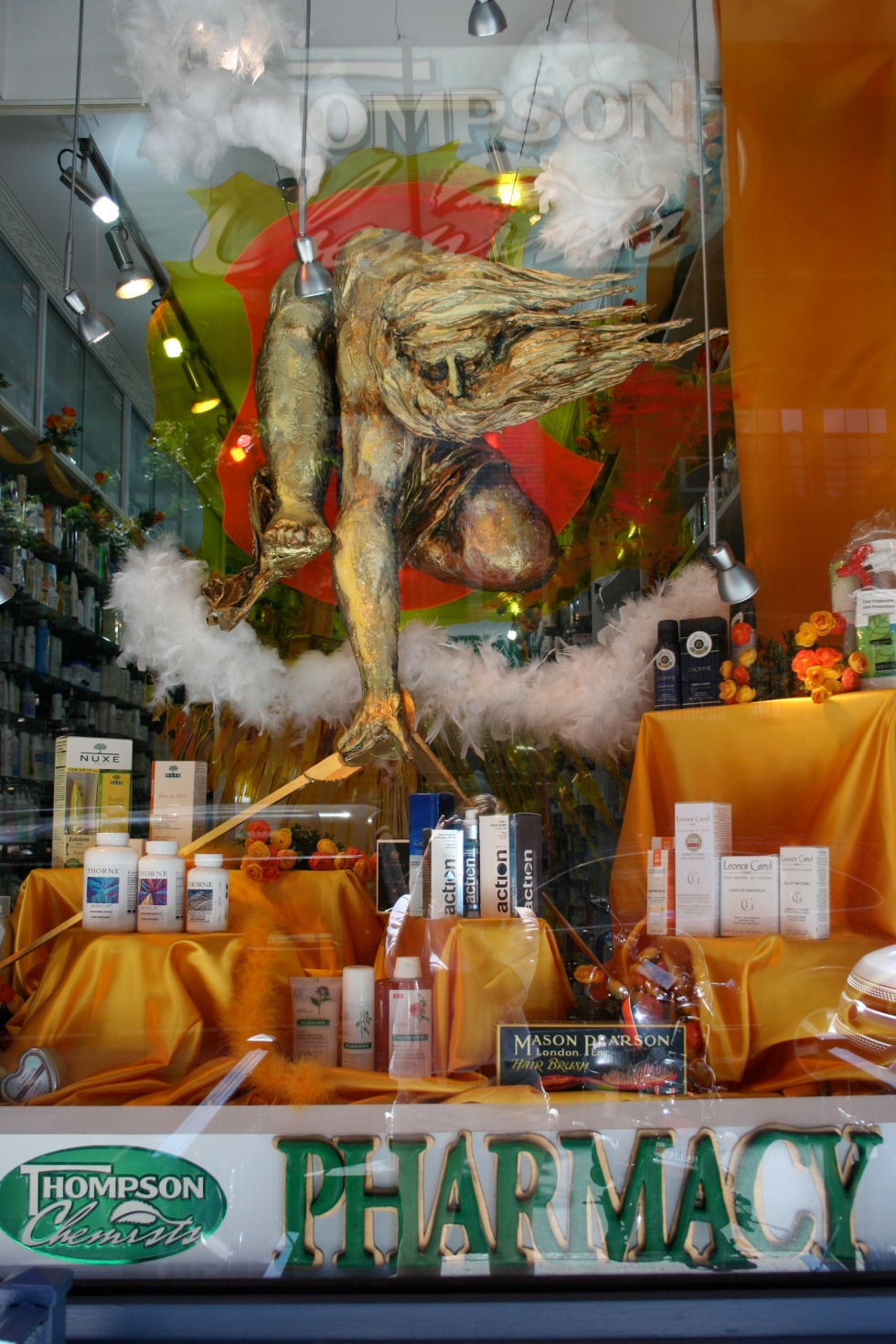 a picture of a sculptured replica of Blake's Ancient of Days that was on display at Thompson Chemists